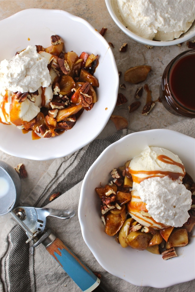 These Caramel Baked Apple Ice Cream Sundaes are loaded with brown sugar and cinnamon baked apples and homemade salted caramel sauce! | The Millennial Cook #fallrecipe #icecream #sundae #apple #caramel