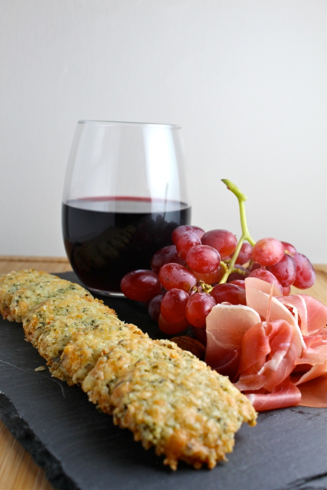 These rich, flaky, and extra cheesy Cheddar Herb Crackers are the perfect snack to pair with red wine! | The Millennial Cook #appetizer #cheeseplate #crackers #cheddar