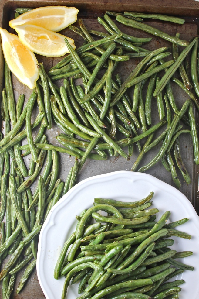 These Roasted Green Beans are dressed with olive oil and lemon juice for the easiest and most delicious side dish! | The Millennial Cook #greenbeans