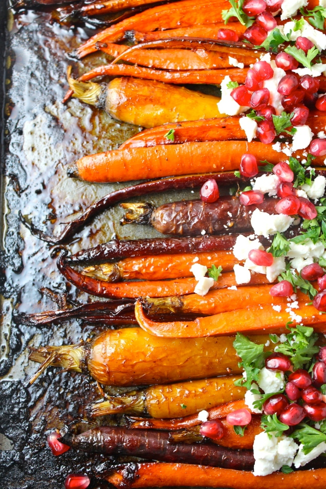 These perfectly caramelized Roasted Pomegranate Carrots are dressed up with pomegranate molasses! | The Millennial Cook #sidedish #vegetables #carrots #roastedcarrots #pomegranate