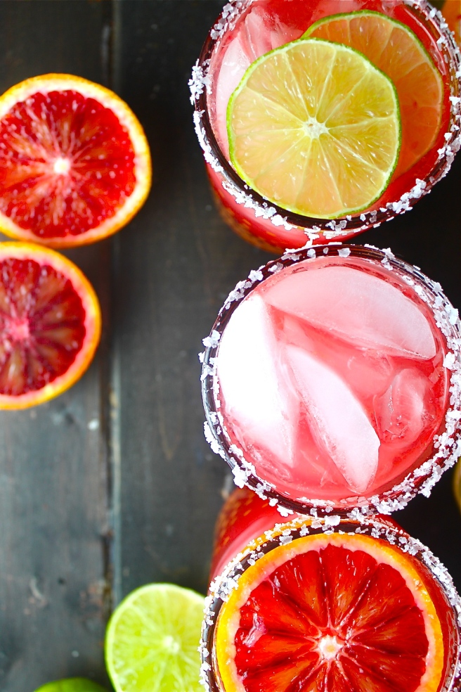 These Blood Orange Margaritas are tart, sweet, and refreshing - the perfect vibrant antidote to the winter gloom! | The Millennial Cook #winterrecipe #drink #margarita #bloodorange #lime
