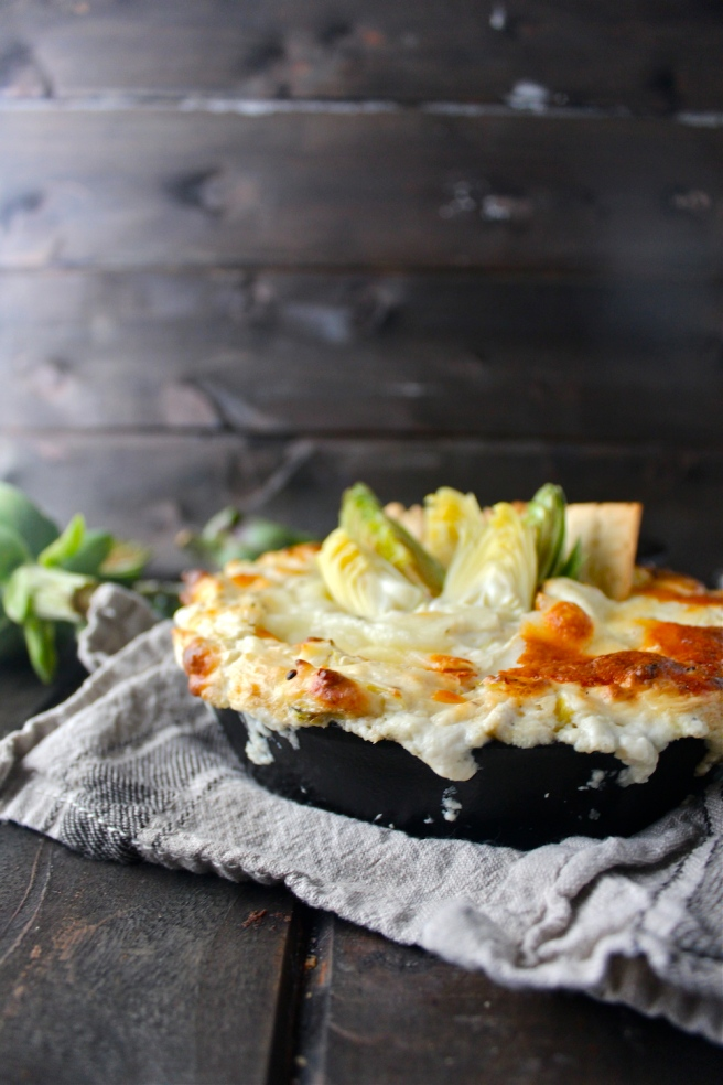 This Creamy Artichoke Dip - with lots of tangy cream cheese, rich mozzarella, and chopped artichokes - is a decadent and delicious party appetizer! | The Millennial Cook #appetizer #artichokedip #artichoke #creamcheese
