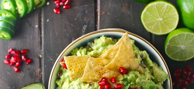 This Pomegranate Guacamole is such a fun and festive appetizer - plus, it's so easy! | The Millennial Cook #winterrecipe #appetizer #guacamole #avocado #pomegranate #lime