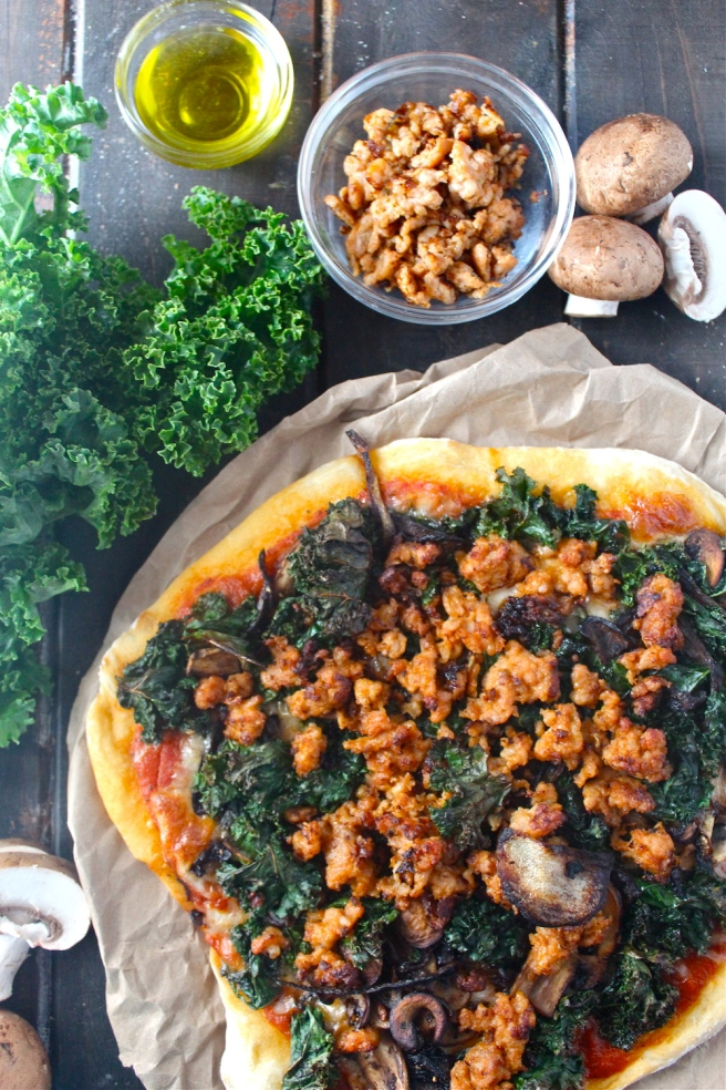 This Sausage & Kale Pizza is topped with the perfect hearty and savory flavors for winter! | The Millennial Cook #winterrecipe #pizza #sausage #kale