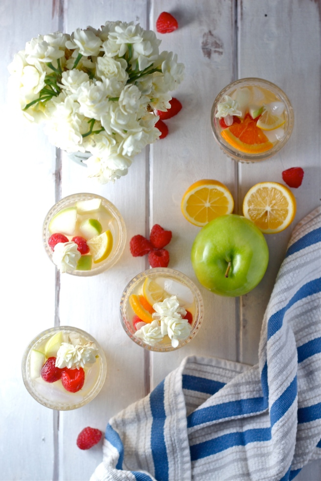 This White Wine Sangria is light, refreshing, and fruity - so perfect for summer! | The Millennial Cook #drink #cocktail #wine #whitewine #sangria