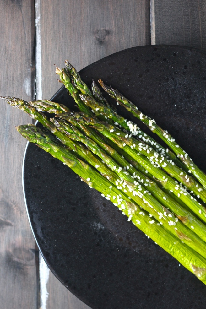 This Roasted Sesame Asparagus is a delicious Asian-inspired twist on my favorite spring vegetable! | The Millennial Cook #springrecipe #asparagus #roastedasparagus #sesame