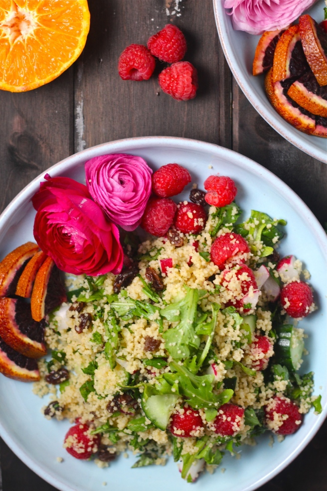 This flavorful Spring Couscous Salad is filled with peppery arugula, fresh raspberries, and crunchy vegetables! | The Millennial Cook #spring #springrecipe #salad #couscous