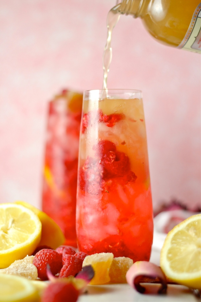 This Raspberry Ginger Kombucha Cocktail is so light and refreshing! | The Millennial Cook #spring #springrecipe #cocktail #vodka #kombucha #raspberry #ginger