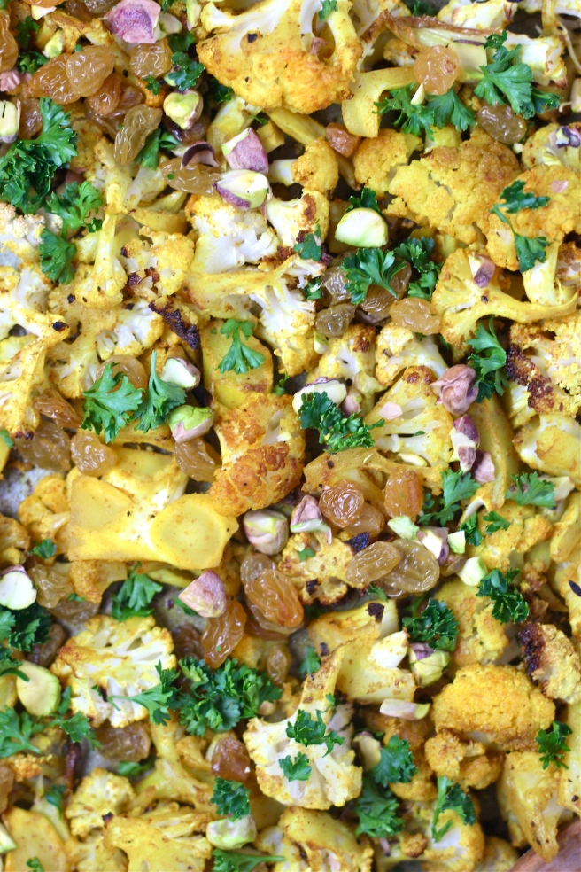 This Turmeric Roasted Cauliflower Salad is a light and tasty dish filled with roasted cauliflower, turmeric, cumin, golden raisins, and bright lemon juice| The Millennial Cook #salad #cauliflower #turmeric