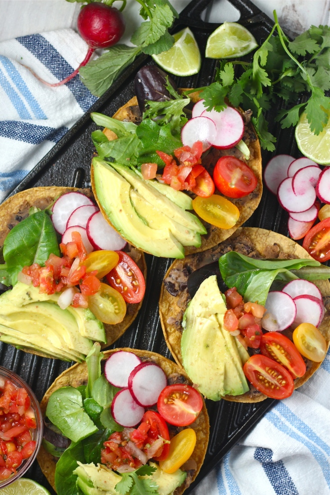 These Vegan Black Bean Tostadas are an easy homemade dinner to satisfy any Mexican craving| The Millennial Cook #mexican #tostada #avocado #vegetarian #vegan