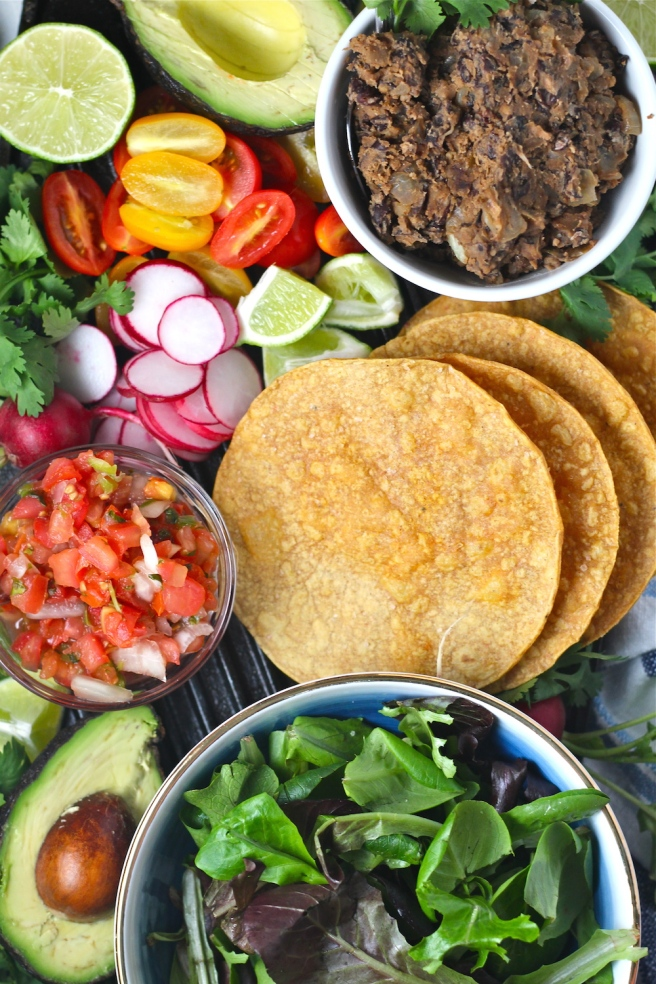 These Vegan Black Bean Tostadas are an easy homemade dinner to satisfy any Mexican craving! | The Millennial Cook #mexican #tostada #avocado #vegetarian #vegan